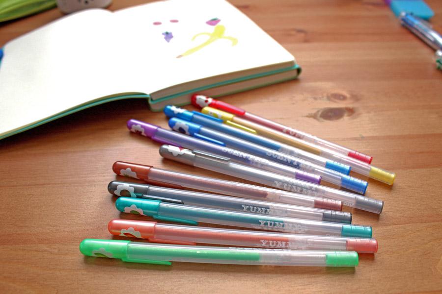Yummy Yummy Glitter Gel Pens on a desktop with a Flipside journal