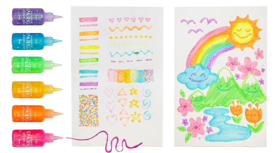 rainbow of glitter glue bottles next to glitter art on white paper