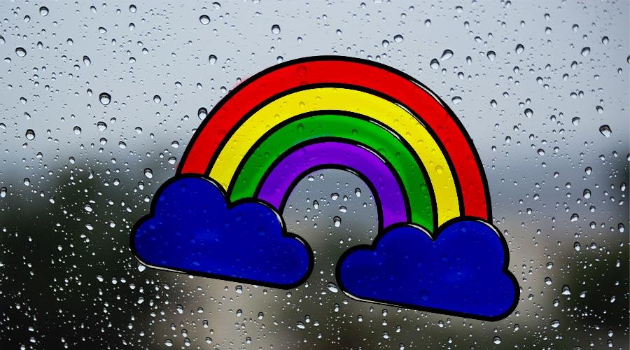 completed rainbow window art on window with raindrops