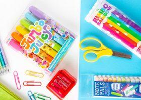 rainbow school supplies on colorful backgorund
