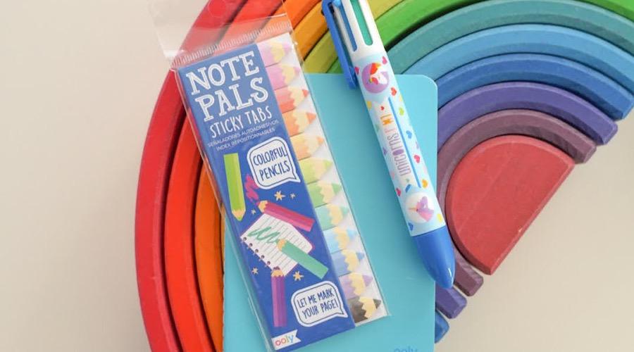 school supplies on top of wooden rainbow blocks