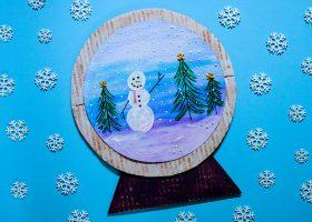 paper snow globe on blue background