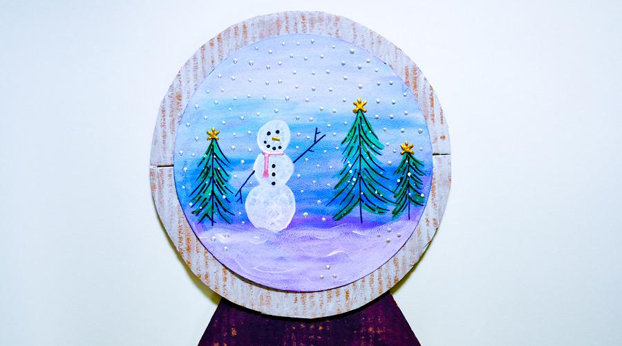 winter scene on paper snow globe