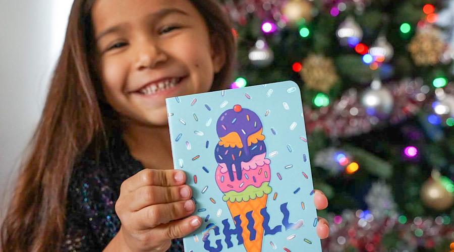 smiling girl holding notebook