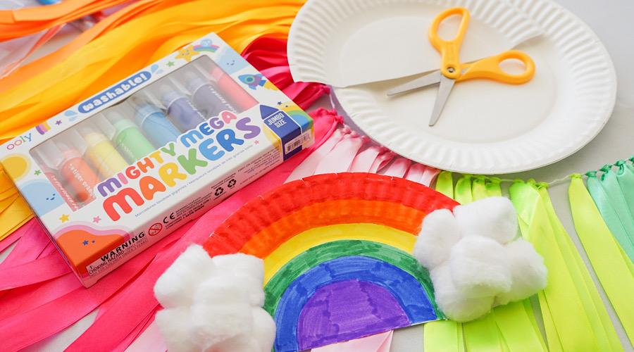 rainbow craft and rainbow markers on rainbow banner